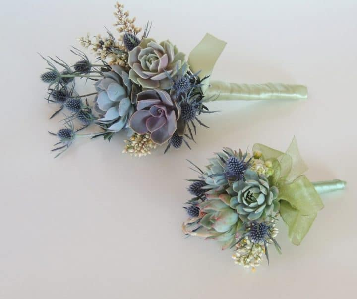 Two succulent bridesmaids bouquets with blue thistle.