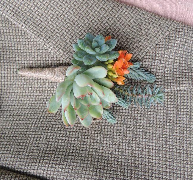 boutonniere with orange bloom