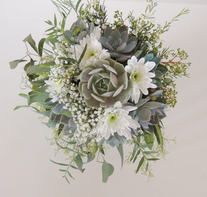 Succulent bridal bouquet with eucalyptus for spray effect.