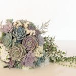 succulent wedding bouquet with pastel colors.