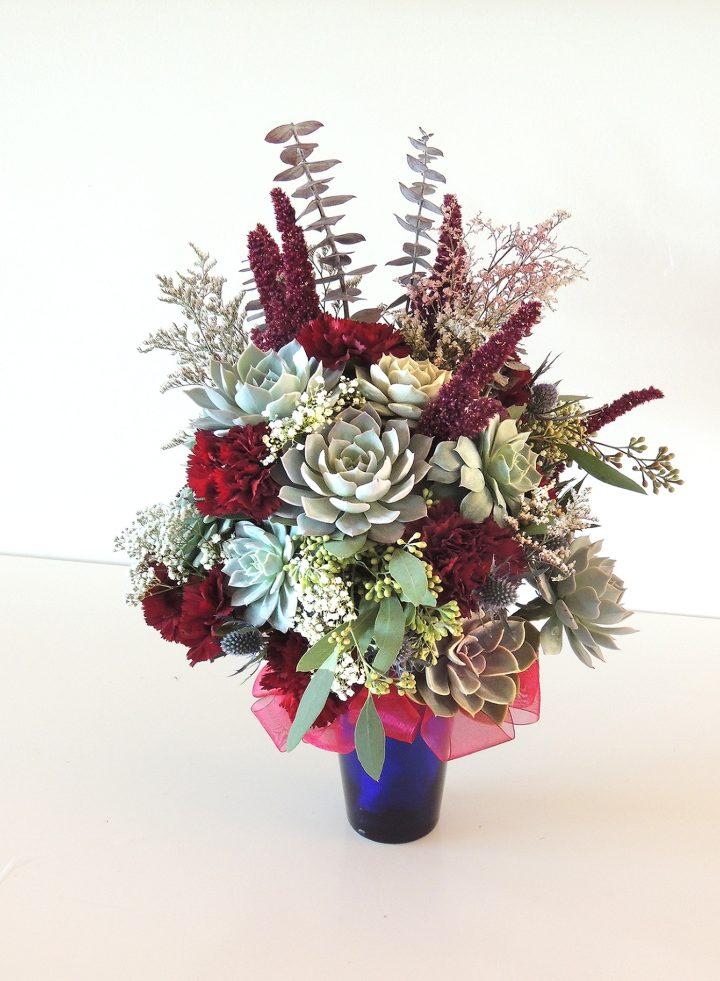 Blue and burgundy succulent bouquet