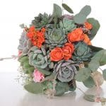 Succulent bouquet with orange spray roses, babies breath and silver dollar eucalyptus.